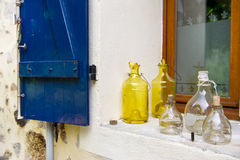 Old glass bottles in window Stock Photography
