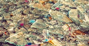 Old glass broken into small shards. Close view stock images