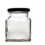 Old glass jar with lid isolated on black. Empty. Retro square jar with black screw top lid Royalty Free Stock Photo