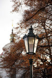 Old glass lantern. In autumn city park Royalty Free Stock Photo