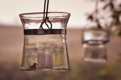 Old glass lantern with white candle. Royalty Free Stock Image