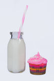 Old glass of milk with cupcake Royalty Free Stock Photography