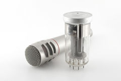 Old glass triode (valve) and microphone Royalty Free Stock Photography