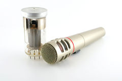 Old glass triode (valve) and microphone Royalty Free Stock Image