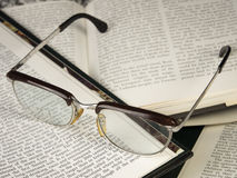 Old glasses. On open books Royalty Free Stock Photos
