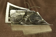 Old glasses. & old photoes on red Royalty Free Stock Images