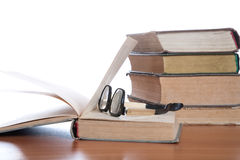 Old glasses and the book Stock Photo