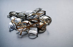 Old glasses. Bunch of old eyeglasses on desk Royalty Free Stock Photography