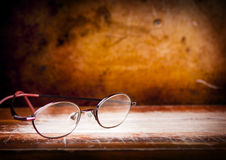 Old Glasses on Desk Stock Photos