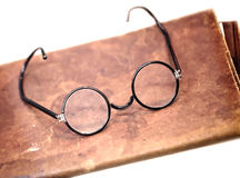 Old glasses on the leather folder Stock Photo
