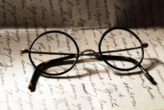 Old glasses on a letter Royalty Free Stock Images