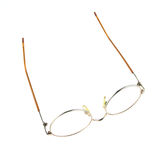 Old glasses for problem vision put upturned isolated Royalty Free Stock Photo