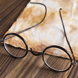 Old glasses on the vintage document Stock Images