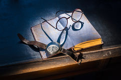 Old glasses and watch Royalty Free Stock Image