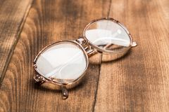 Old glasses on wooden surface royalty free stock images