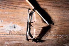 Old glasses on wooden table Stock Photography