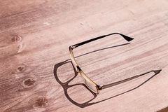 Old glasses on wooden table Stock Image
