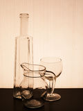 Old glassware silhouetted, tinged brown antique effect. Royalty Free Stock Photography