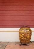Old glazed water jar. And wooden wall Royalty Free Stock Photos