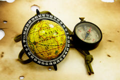 Old globe and compass. Globe and compass on the old paper Stock Photos