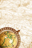 Old globe on map. Old globe on background of map Stock Image
