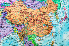 Old Globe Map of China close-up. Old globe map close-up showing the regions of China stock photo
