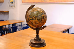 Antique globe. A vintage antique globe in a classroom Stock Images