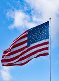 Old Glory Against a Blue Sky and Clouds Royalty Free Stock Images
