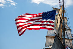 Old glory flies on American tall ship Eagle. Halifax, Nova Scotia (Canada) - The American Flag Stars and Stripes flies off the rear stern section of US tall ship royalty free stock images