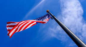 American Flag. Looking up at an American Flag against a beautiful blue sky Stock Photos