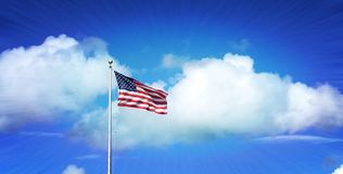Proud to be the glory of `Old Glory`, American flag highlighted by cumulus cloud and a deep blue sky. royalty free stock photo