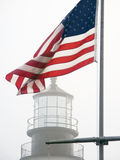 Old Glory and Portland Head Light Royalty Free Stock Images