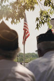 Old Glory shining through. Veterans gather during a Memorial Day program in Galena, IL Royalty Free Stock Photos