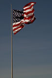 Old glory unfurled. An American Flag  flying in the breeze on a clear windy day Stock Image