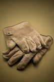 Old gloves. Old tattered leather work gloves Stock Image