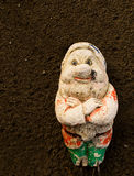 Old gnome on fine tilth soil background Stock Image