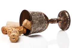 Old goblet and wine corks Stock Photos