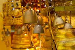 Old gold bell in buddhist temple. Stock Image