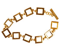 Old gold chain bracelet made of large square links Stock Photos