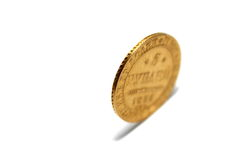 Old gold coin isolated on a white background Stock Photos