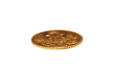 Old gold coin isolated on a white background Royalty Free Stock Image