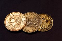 Old Gold Coins. On a dark background royalty free stock photo