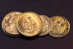 Old Gold Coins. On a dark background royalty free stock photography