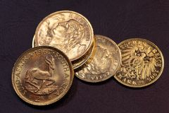 Old Gold Coins. On a dark background stock images