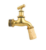Old gold faucet closed with cork isolated Stock Image