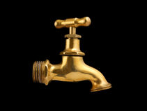 Old gold faucet isolated Royalty Free Stock Photos