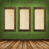 Old gold frames Victorian style on the wall Stock Images