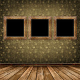 Old gold frames Victorian style on the wall. In the room Royalty Free Stock Images
