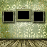 Old gold frames Victorian style on the wall Stock Photos