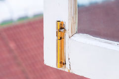 Old gold hasp on old vintage greed wooden window Royalty Free Stock Image